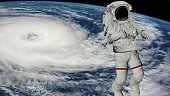 Astronaut Spacewalk, Astronaut shows thumbs up in the open space. Earth with a Hurricane. Elements of this video furnished by NASA