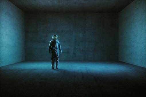 Astronaut standing in empty spaceship room