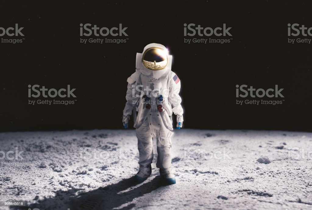 Astronaut standing on the moon surface stock photo