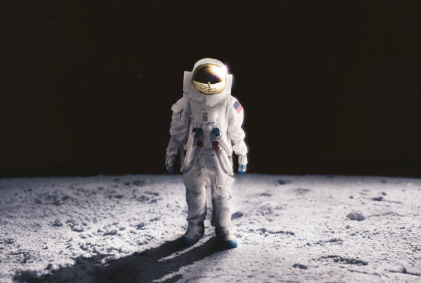 astronaut standing on the moon surface - moon stock pictures, royalty-free photos & images