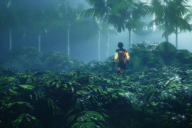 Astronaut walking in jungle on distant planet - foto de acervo