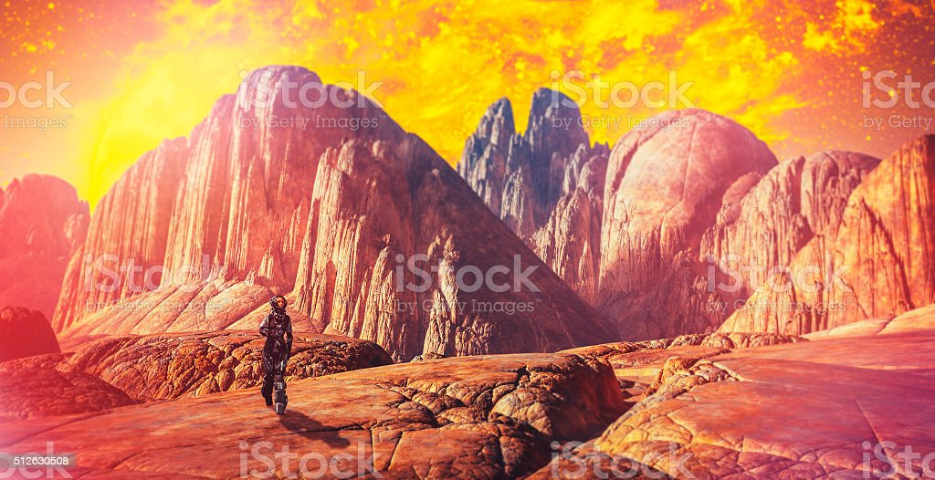 Astronaut walking on alien planet stock photo