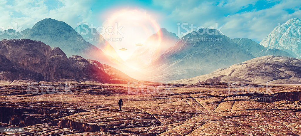 Astronaut walking on alien planet, UFO portal stock photo