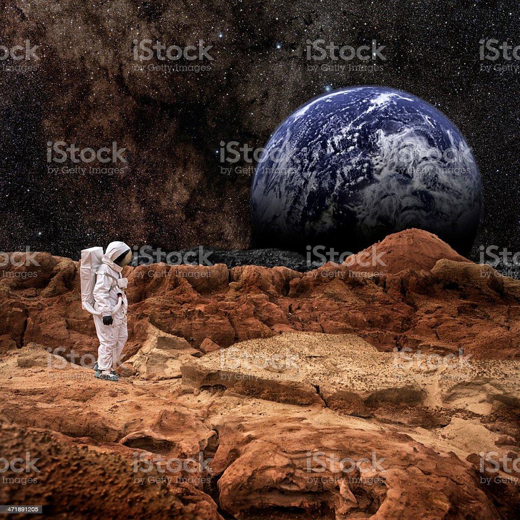 Astronaut Walking On Mars or the Moon stock photo