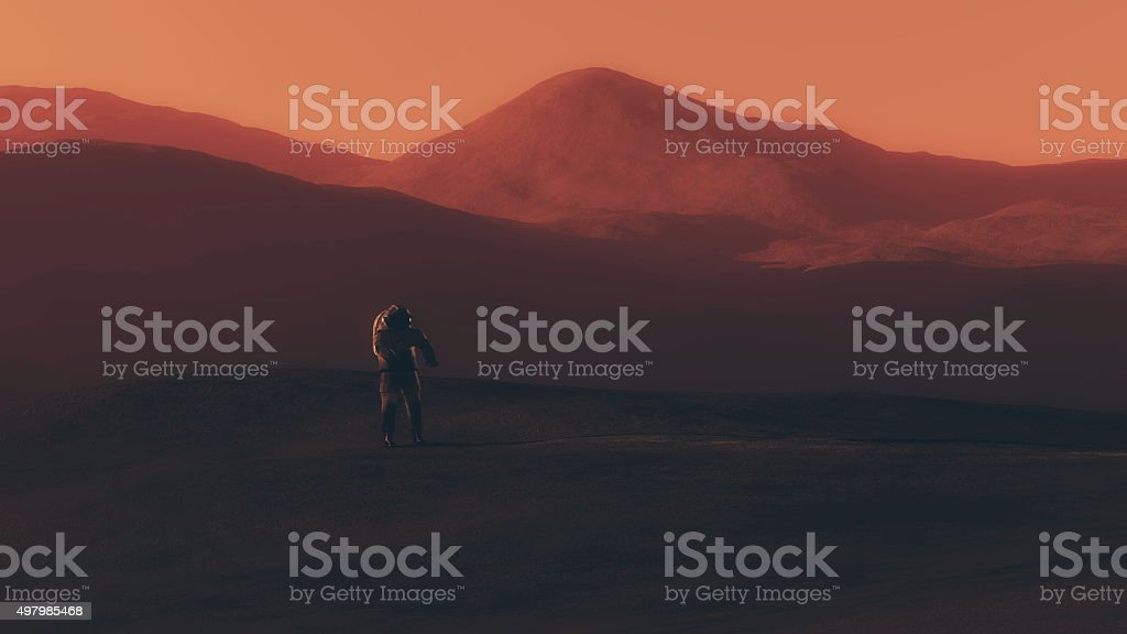 Astronaut walking on red planet. stock photo