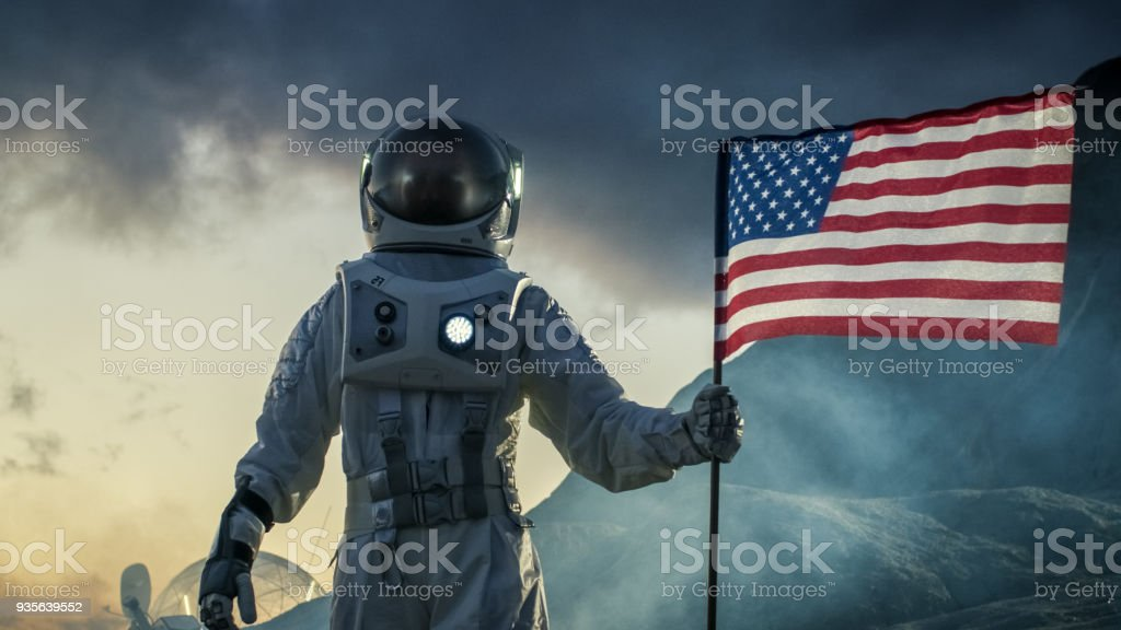 Astronaut Wearing Space Suit Plants American Flag On The Red