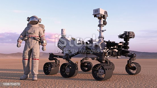 istock Astronaut with mars rover, cosmonaut standing next to robotic space autonomous vehicle on a deserted planet, 3D rendering 1006754370