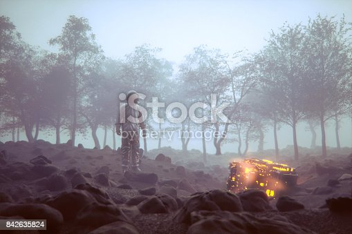 istock Astronaut with mysterious glowing alien object 842635824