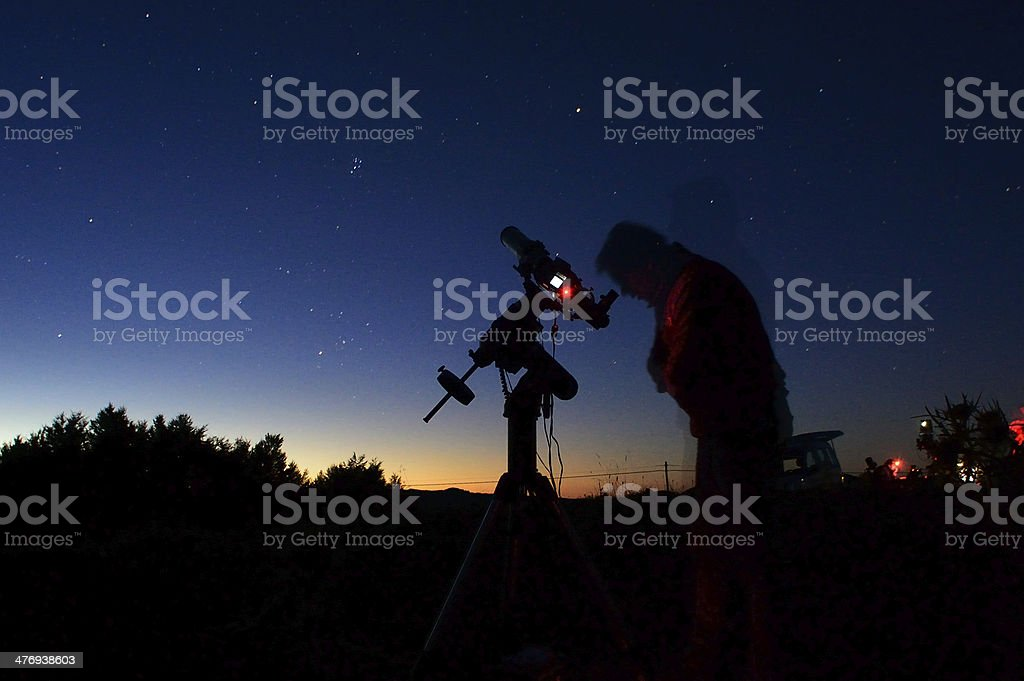 Astronomer in the night stock photo