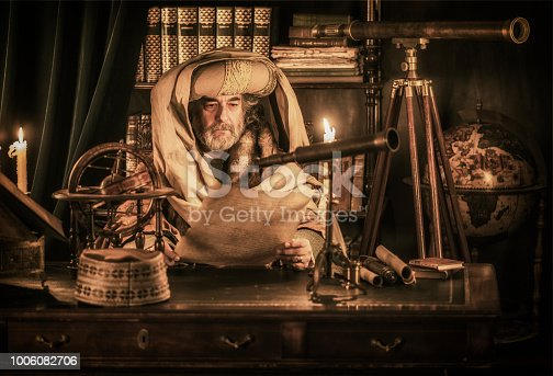 Astronomer reading ancient document
