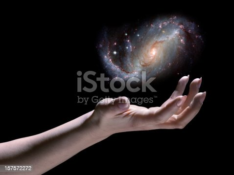 Astronomer; Galaxy in Hand. This image is meant to be inspirational, a visual metaphor for the power of scientific study of the Universe.