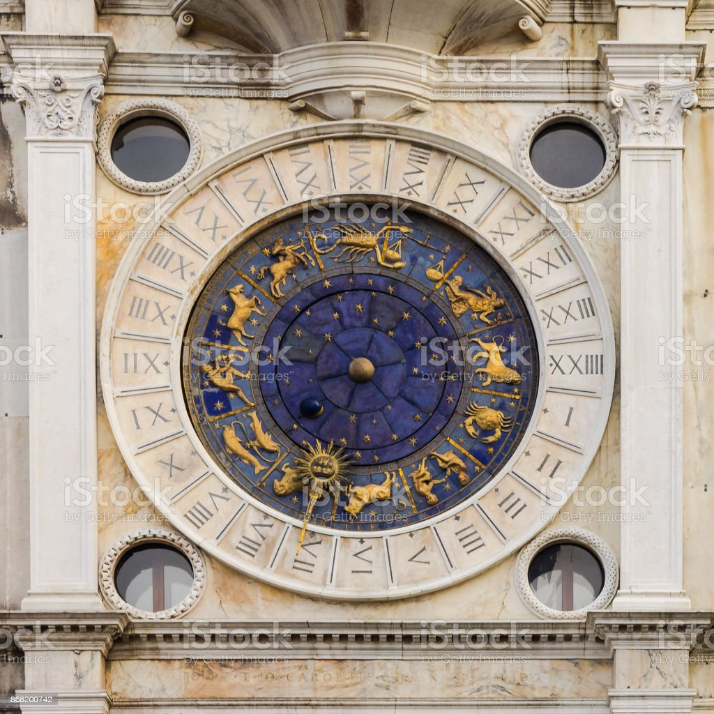 Astronomic clock at a tower at St. Mark's square, Venice, Italy stock photo