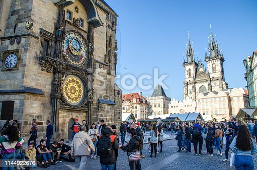 Astronomical clock and church of our lady before týn  in Prague with people during day