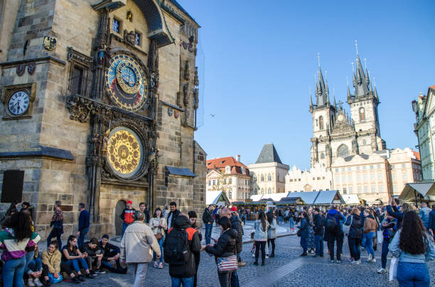 Astronomical clock and church of our lady before týn in Prague Astronomical clock and church of our lady before týn  in Prague with people during day astronomical clock prague stock pictures, royalty-free photos & images