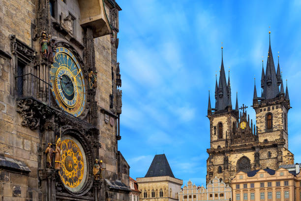 Astronomical clock and Church of Our Lady before Tyn in Prague. Famous astronomical clock and Church of Our Lady before Tyn on background in Prague, Czech Republic. astronomical clock prague stock pictures, royalty-free photos & images