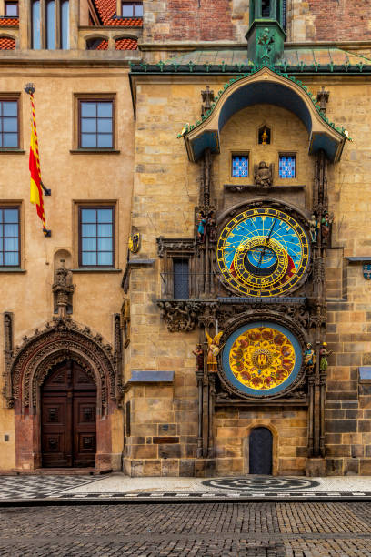 Astronomical Clock in Prague Building Facade and Astronomical Clock in Prague Old Town Square astronomical clock prague stock pictures, royalty-free photos & images