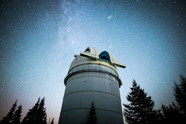 Astronomical Observatory under the night sky stars. Vignette stock photo