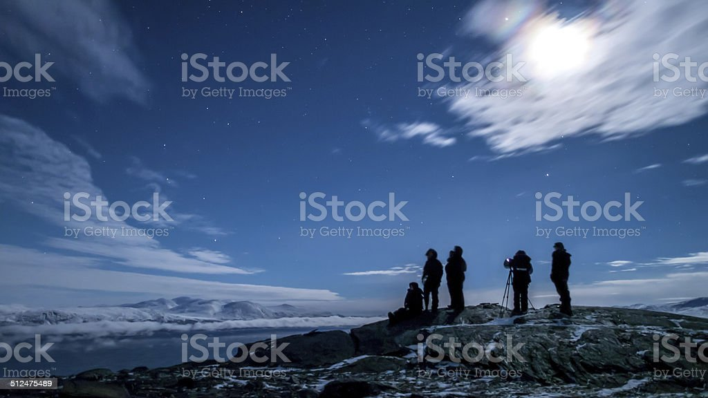 astrophotography in a mountainous terrain with snow stock photo