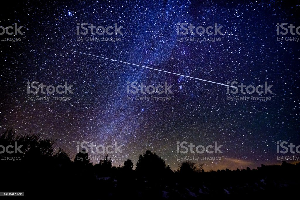 Astrophotography Meteor Shower with Milky Way Galaxy and Stars stock photo