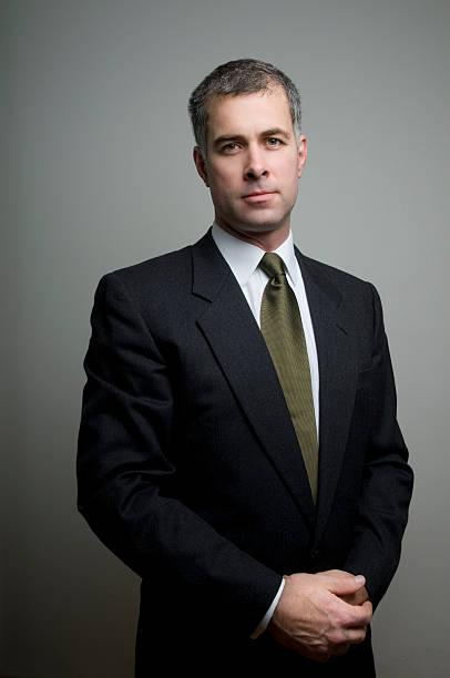 Astute and trustworthy businessman stock photo