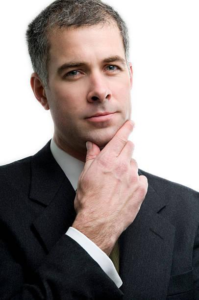 Astute businessman contemplates the future stock photo