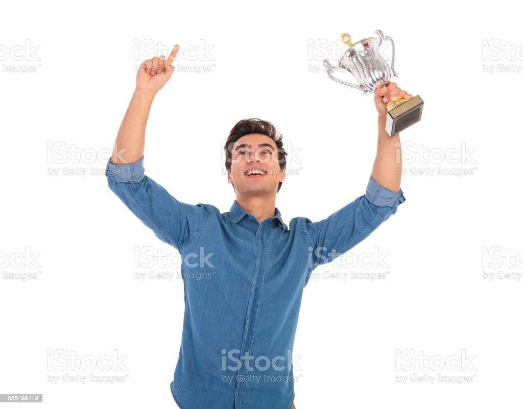 asual man with hands in the air celebrating success stock photo