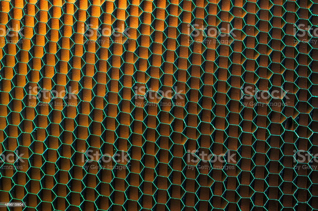 Asymetric abstract textured background of honeycomb mesh grid stock photo