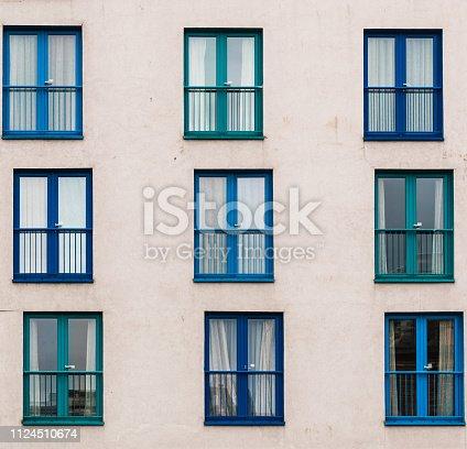 Windows arranged asymmetrically on the facade of a building