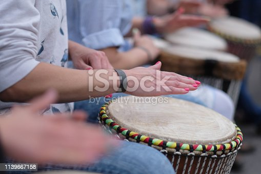Speech by a group of girls playing ethnic drums at a concert of percussion music