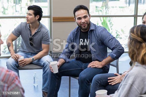 istock At break time in therapy, members chat together 1174210581
