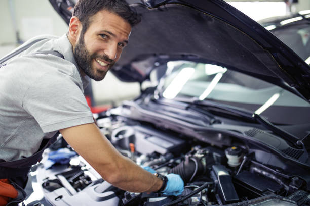 At car service At car service repairman stock pictures, royalty-free photos & images