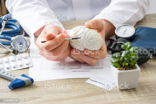 At doctors appointment physician shows to patient shape of brain with picture id1139068109?b=1&k=6&m=1139068109&s=612x612&h=hni0v0zgmfhlkkcnztbilpzwxbiruavtjfiep4d7xwy=