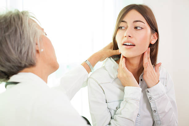 At doctor's office Doctor endocrinologist testing young woman patient at office endocrine system stock pictures, royalty-free photos & images