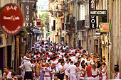 Pamplona, Spain - July 8, 2013: People on street  during San Fermin festival in Pamplona