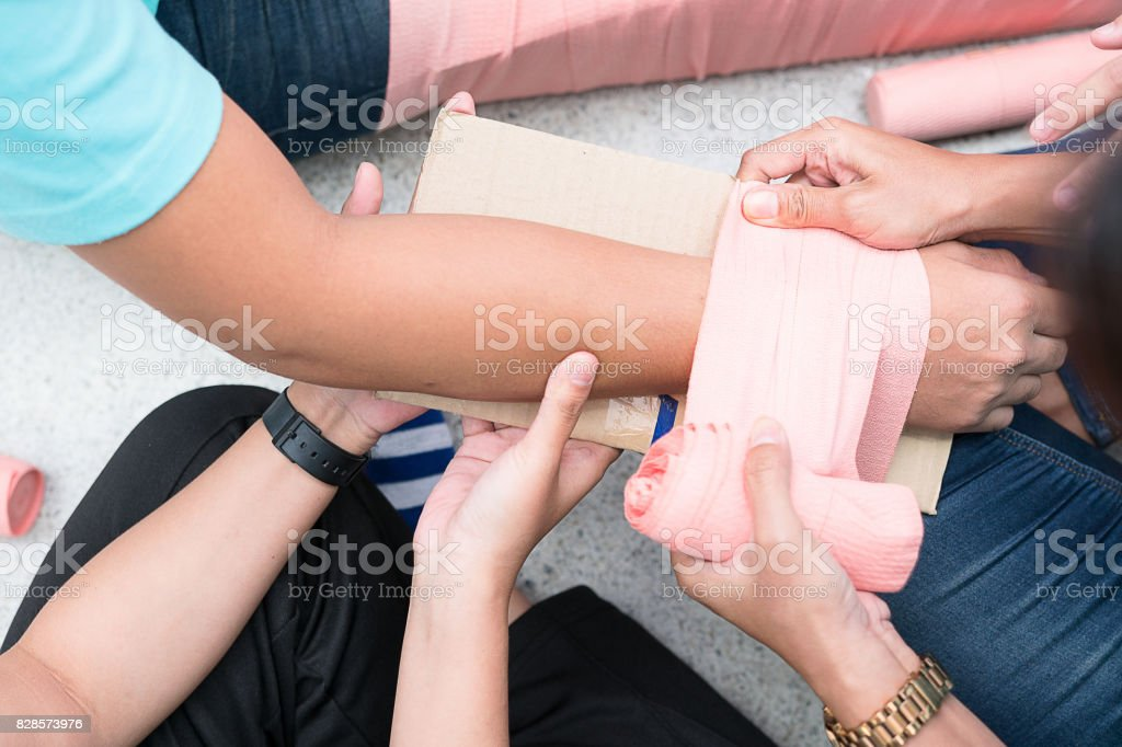 At First Aid Training Classroom Students Are Trying To Splint The