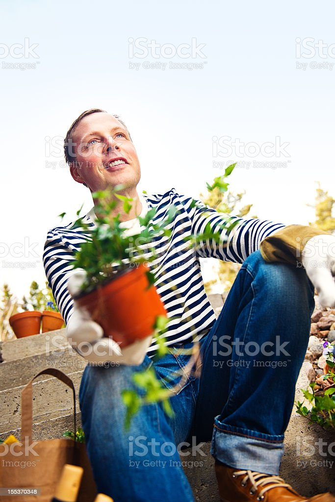 At home with his pots and plants royalty-free stock photo