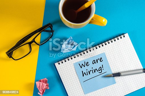 1153648747istockphoto WE'RE HIRING CONCEPT at Human Resources Manager workplace. Job recruiting advertisement 908849824