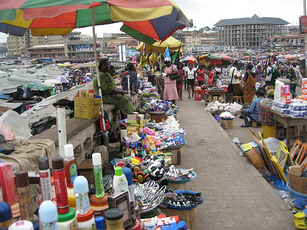 fmcg at large kumasi central market, ghana, west africa - kente cloth stock photos and pictures