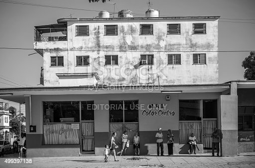 Havana, Cuba- November 6, 2015. Typical Havana public transport bus stop, in front of the grocery shop. Miramar, suburbs of Havana, Cuba. Busy city avenue. People waiting in the shade of the bus shelter for a next ride to center of the city. Everyday scene on a working day in capital of Cuba.