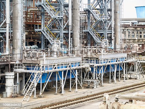 1071156490 istock photo At modern chemical plant. Air cooling system with electric motors and synthesis columns of chemical production 1098349432