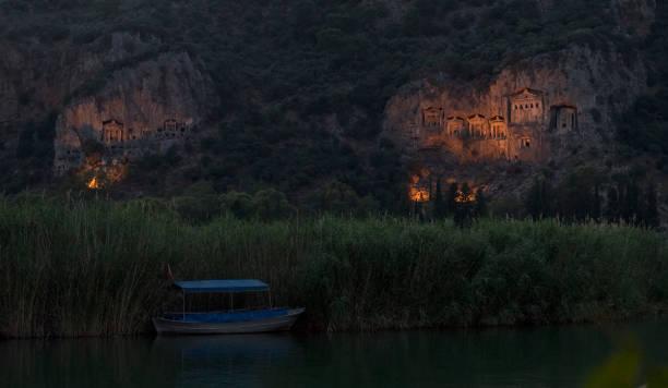 At Night, Ancient City of Caunos and Rock King Tombs in Dalyan, Ortaca, Muğla, Turkey stock photo