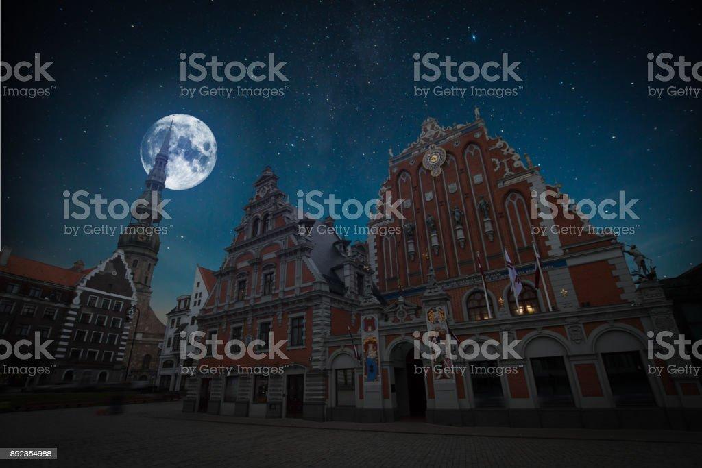 At night the moon and stars shine. stock photo