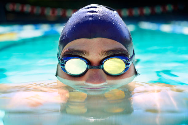 At one with the water Cropped view of a determined male swimmer swimming laps swimming goggles stock pictures, royalty-free photos & images