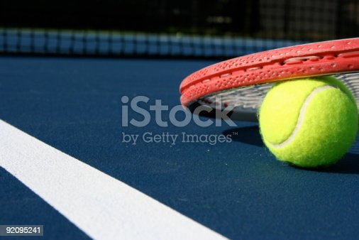 1153628111istockphoto At Play on a Blue Tennis Court 92095241