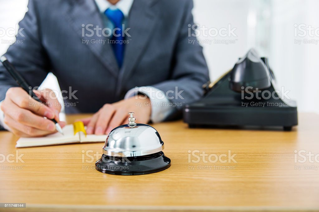 at reception desk stock photo