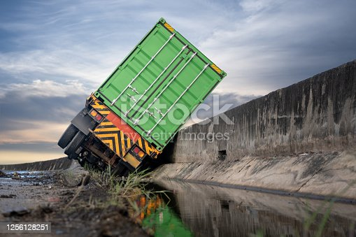truck trailer lorry transport delivery container unit in clashed accident on the roadside, drive at rist of the high level of insurant