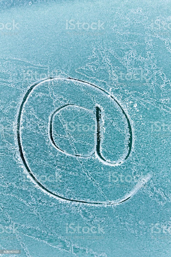 At sign, drawn on a frozen car window. – Foto