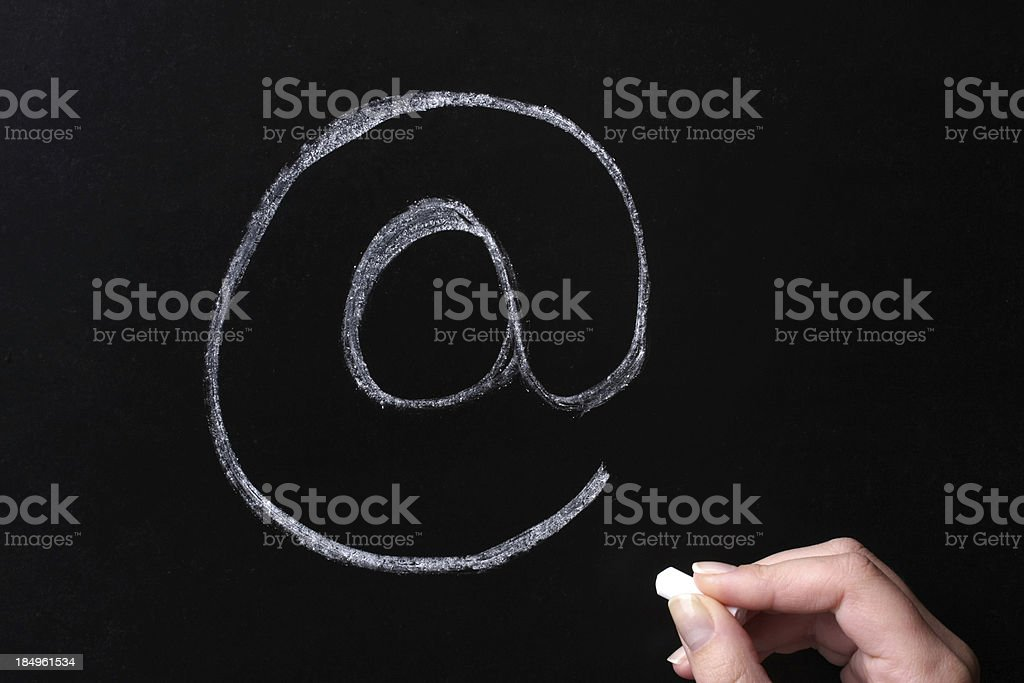 'at' Symbol on School Blackboard royalty-free stock photo