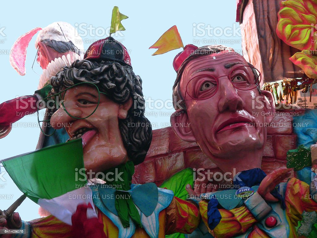 Cento, Emilia-Romagna, Italy - march 6, 2011: at the Carnival the faces of two old Italian political leaders, Bossi and Fini, on the Italy float that is moving down the narrow streets of the town. Not people stock photo