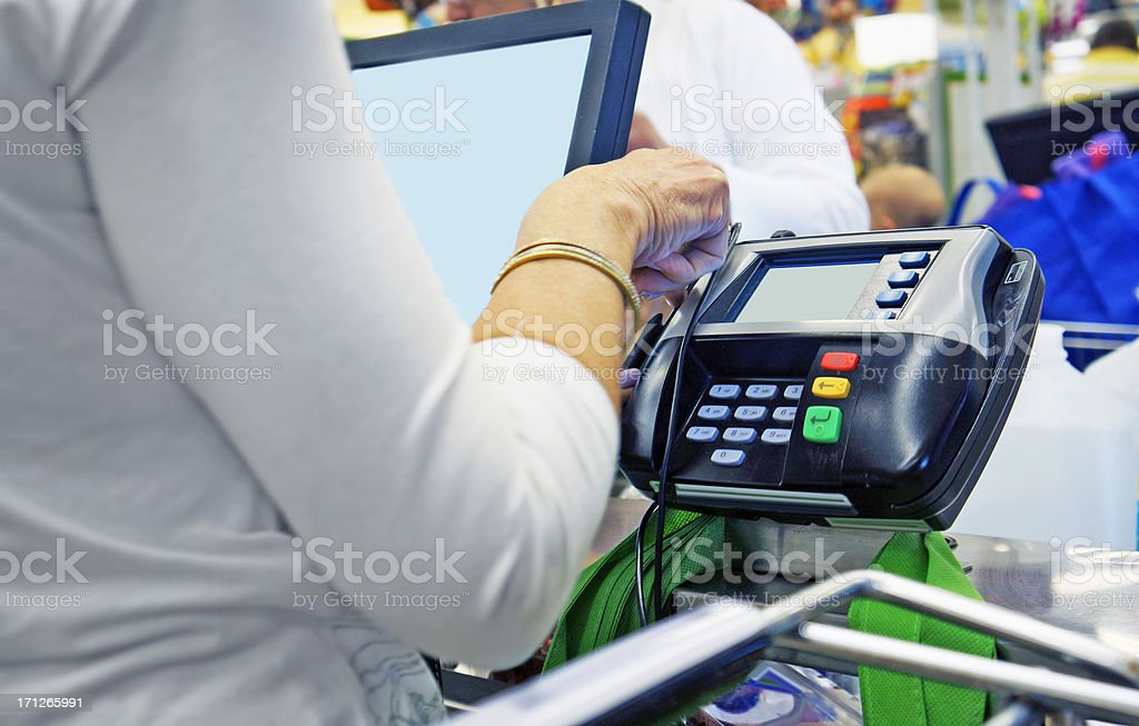 At the cash register. stock photo